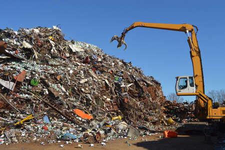 snatch: Crane grabber snatch recycling metal at a scrap-iron junk