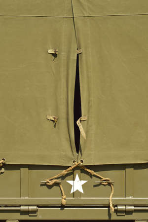 Cape in canvas top of vintage American military vehicle - space for text photo
