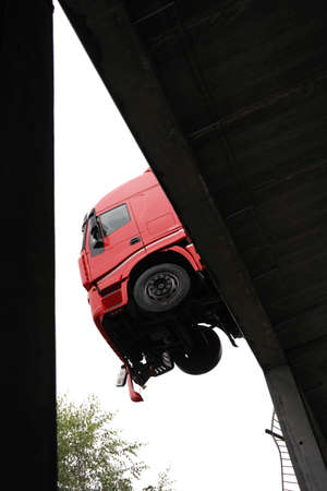 hangs: SPA-FRANCORCHAMPS, BELGIUM - JULY 28  A truck hangs off a parking deck after a break through the railings of circuit paddock on July 28, 2014 in Francorchamps, Belgium