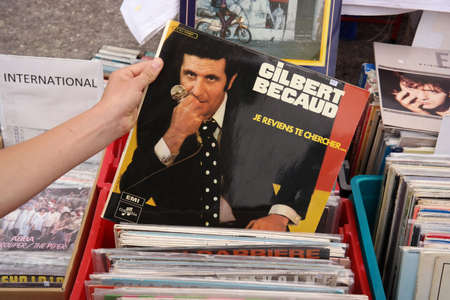 gilbert: FRANCE - JULY 2014  LP record of the French singer, composer, pianist and actor Gilbert Becaud 1927 � 2001 on a flea market on July 20, 2014 in Brittany, France Editorial