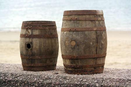 Two old wooden barrels for distilled beverage at a flea market in Brittany, France