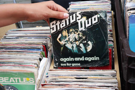 BELGIUM - JULY 2014  Single record of the English rock band Status Quo on a flea market Stok Fotoğraf - 30738841