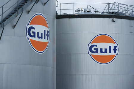 naming: HARLINGEN, NETHERLANDS - AUGUST 2014  Gulf oil storage tank, Gulf Oil LP is a major American oil company formed when Cumberland Farms acquired the naming rights to the Gulf Oil brand from Chevron