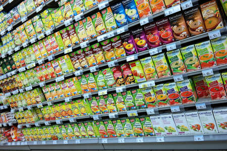 mart: FRANCE - JULY 2014  Shelf filled with cartons of soup in a Carrefour supermarket