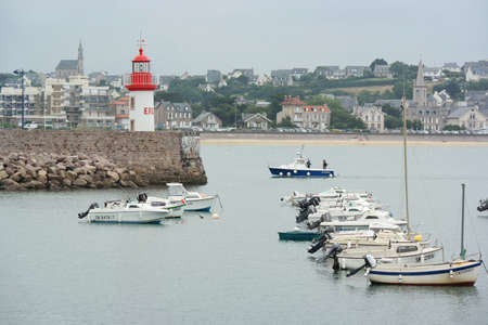 cotes d armor: ERQUY, FRANCE - JULY 2014  Lighthouse and boats in harbour of Erquy, Cotes d Armor in Brittany