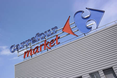 DUCEY, FRANCE - JULI 2014  Brand name on facade of a Carrefour market, Carrefour is a French multinational retailer, one of the largest supermarket chains in the world