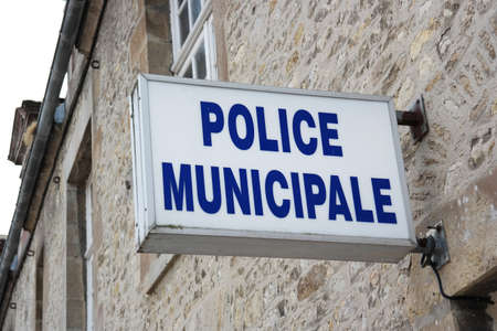 local government: Detail of a french police station and sign. Municipal police in France are law enforcement agencies that are under the control of local government