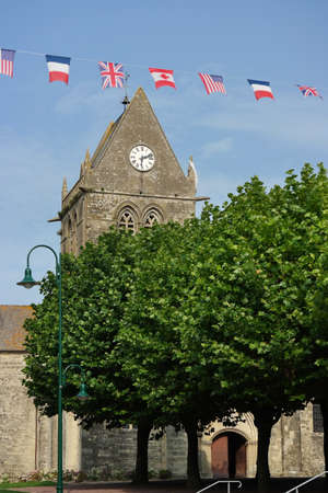 allied: Sainte-Mere-Eglise Church and flags of the allied liberators. The church played a role on D-Day, June 1944