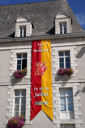 hugely: DINAN, FRANCE - JULY 2014: Banner announced on a medieval event - Fete des remparts, a hugely popular Knights Festival on July 20, 2014 in old city of Dinan, France