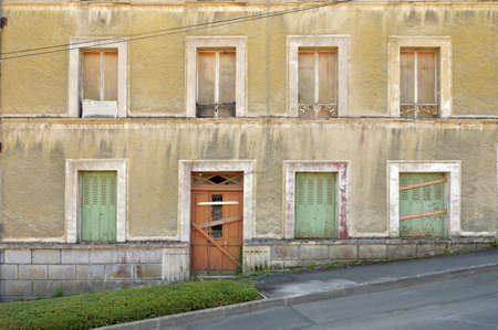 renovate old building facade: SAINT-BRIEUC, FRANCE - JULY 2014: Handwritten sign, A Vendre, for sale on an expired house in the town of Saint Brieuc, Brittany Editorial