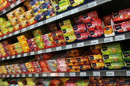 GERMANY - SEPTEMBER 2014  Shelf filled with boxes of pre-packed tea in a K+K supermarket