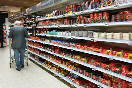 carrefour: WALLONIA, BELGIUM - OCTOBER 2014: Shelves with a variety of chocolate products in a Carrefour Hypermarket