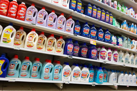 carrefour: WALLONIA, BELGIUM - OCTOBER 2014: Bottles liquid laundry detergent on display in a Carrefour Hypermarket in Belgium Editorial