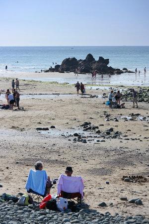 sun bathers: BRITTANY, FRANCE - JULY 2014: Plage Saint Pabu, bathers at St. Pabu beach near Erquy in Brittany, France Editorial