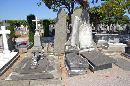 slantwise: SAINT-BRIEUC, FRANCE - JULY 2014: Prolapsed graves of the Cemetery of Saint Michel in St. Brieuc, Brittany