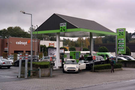 retailing: WALLONIA, BELGIUM - OCTOBER 2014: Colruyt Group retail corporation in Europe have branched into petrol retailing, as shown by a DATS 24 filling station beside a supermarket in Belgium and France Editorial