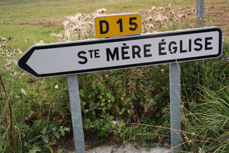 mere: Traffic direction sign for town of St. Mere Eglise, the place played an important role in 1944 on D-Day in Normandy, France Editorial