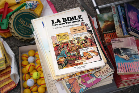 FRANCE - JULY 2014:   A French Bible in cartoon strips on a flea market in Brittany, France