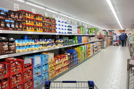 grocery trade: NORDHORN, GERMANY - DECEMBER 2014:  Shelves with a variety of coffee products in a Aldi supermarket, Aldi is a leading global discount supermarket chain with over 9,000 stores in over 18 countries
