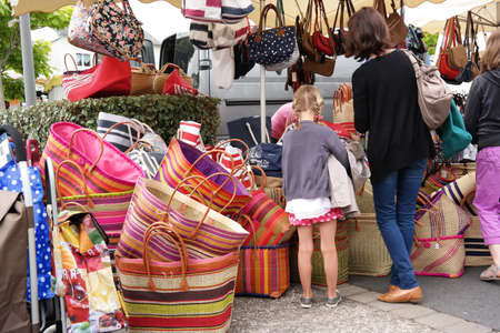 cotes d armor: ERQUY, FRANCE - JULY 2014:  Market stall with woven bags at a marketplace in Erquy, Cotes d Armor in Brittany