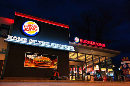 us sizes: NORDHORN, GERMANY - DECEMBER 2014:  Night scene of a Burger King restaurant. BK is a global chain of hamburger fast food restaurants , the company consists of over 13,000 outlets in 79 countries