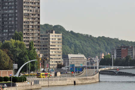 liege: LIEGE, BELGIUM - AUGUST 2011: Boulevard Frere-Orban and Pond J.F. Kennedy. The Meuse river flowing through Liege, Belgium Editorial