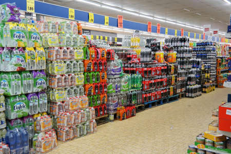 NORDHORN, GERMANY - DECEMBER 2014: Soft drinks department of a Lidl supermarket. Lidl is a German global discount supermarket chain, with over 10,000 stores across Europe.