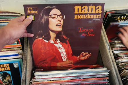 nana: THE NETHERLANDS - AUGUST 2014: LP record of Greek singer Nana Mouskouri in a second hand store