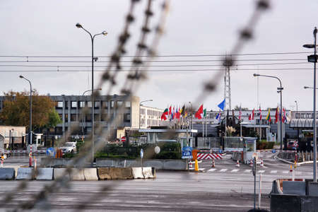 nato: BRUSSELS, BELGIUM - OCTOBER 2014: Barbed wire in front of NATO Headquarters, the political and administrative centre of the Alliance