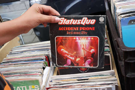 progressive art: BELGIUM - JULY 2014:  Single record of the English rock band Status Quo on a flea market