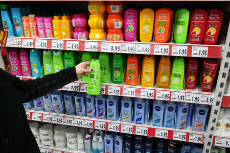 personal decisions: GERMANY - FEBRUARY 2015: Shelves with a variety of Shampoos in a Kaufland supermarket.
