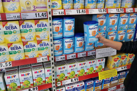 nestle: GERMANY - FEBRUARY 2015: Shelves filled with commercial baby food in a Kaufland supermarket
