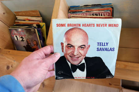 telly: THE NETHERLANDS - MARCH 2015: Single record of the American film and television actor and singer Telly Savalas in a second hand store