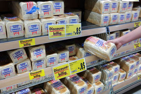 packaged: GERMANY - FEBRUARY 2015: Shelves filled with Amercan style packed sliced bread in a Kaufland supermarket