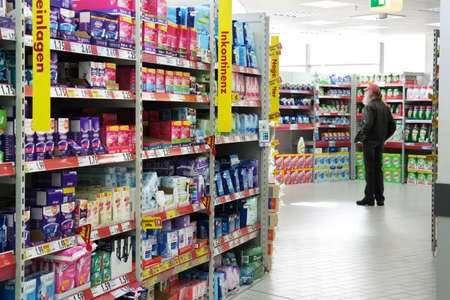 GERMANY - FEBRUARY 2015: Aisle with a variety feminine hygiene products in a Kaufland supermarket. Publikacyjne