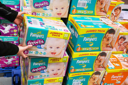 marketed: THE NETHERLANDS - MARCH 2015: Stack of boxes Pampers diapers in a wholesale. Pampers is a brand of baby products marketed by Procter & Gamble.