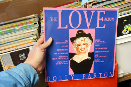 instrumentalist: THE NETHERLANDS - MARCH 2015: LP record of the American singer-songwriter, instrumentalist, actress, author, and philanthropist Dolly Parton in a second hand store
