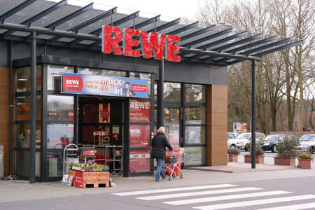 diversified: MEPPEN, GERMANY - FEBRUARY 2015: Entrance of a REWE supermarket, part of the REWE Group, a German diversified retail and tourism group, operates in 14 European countries