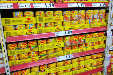 GERMANY - FEBRUARY 2014:  Shelves filled with canned pasta from Maggi, an international brand of instant soups, bouillon cubes, sauces, and instant noodles, owned by Nestl