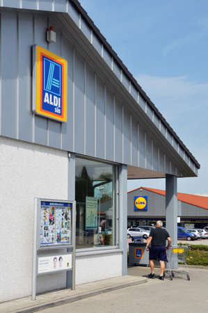 RENCHEN, GERMANY - AUGUST 2012: Aldi and Lidl supermarket near each other. Aldi and Lidl two German supermarket chains are competitors in discount retailing