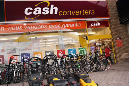 consignment: WAVRE, BELGIUM - OKTOBER 2014: Retail store of Cash Converters International Limited, a worldwide pawnbroking franchise company Editorial