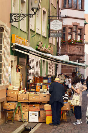 book shop: FREIBURG, GERMANY - AUGUST 16, 2012: Sidewalk sale of a used bookstore in a Old town street in Freiburg, a city in the south-western part of Germany in the Baden-Wurttemberg state.