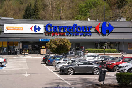retailer: MALMEDY BELGIUM MAY 2015: Entrance and parking lot of a Carrefour hypermarket. Carrefour is a French multinational retailer and one of the largest hypermarket chains in the world.