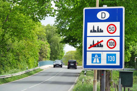 limitations: Sign of speed limits at the German border Stock Photo