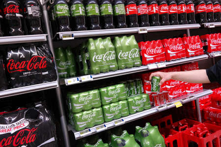 aisle: BELGIUM - MAY 2015: Life Coca Cola, a soft drink produced with stevia and sugar as sweeteners in green package.