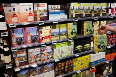 carrefour: MALMEDY, BELGIUM - MAY 7: Shelves with wine Cardboard cartons or 3 liters in a Carrefour Hypermarket. Editorial