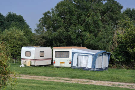 old fashioned: Old-fashioned caravan at farmers campsite in Normandy, France