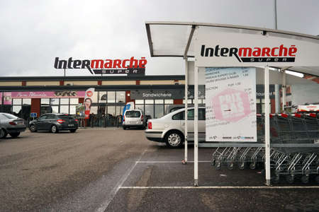 inter: HERVE, BELGIUM - JULY 2015: Entrance and parking lot of a supermarket Inter March, a fire and part of the large french retail group Les Mousquetaires