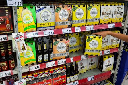 carlsberg: GERMANY - AUGUST 2015: Beer aisle with Radler of different German breweries. Radler is the name of a 50:50 mixture Consists of beer and sparkling lemonade.