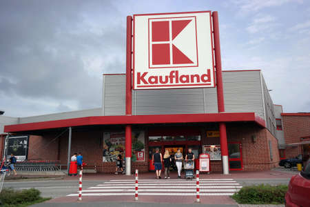 retail chain: PAPENBURG, GERMANY - AUGUST 2015 Entrance of a Kaufland hypermarket, a German discount retail chain, part of the Schwarz Gruppe ook-which owns Lidl and Handelshof.